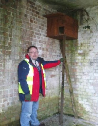 Phil Thomas with one of the many Barn owl boxes monitored across the MoJ estate