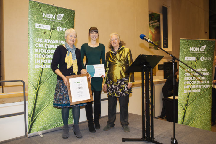 Mary Taylor and Laura Millar receiving the award from Lynne Farrell