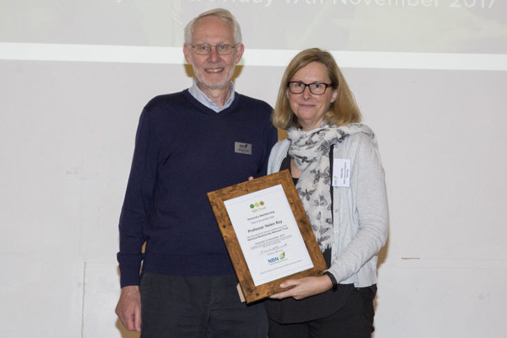 Helen Roy receiving Honorary Membership from Michael Hassell