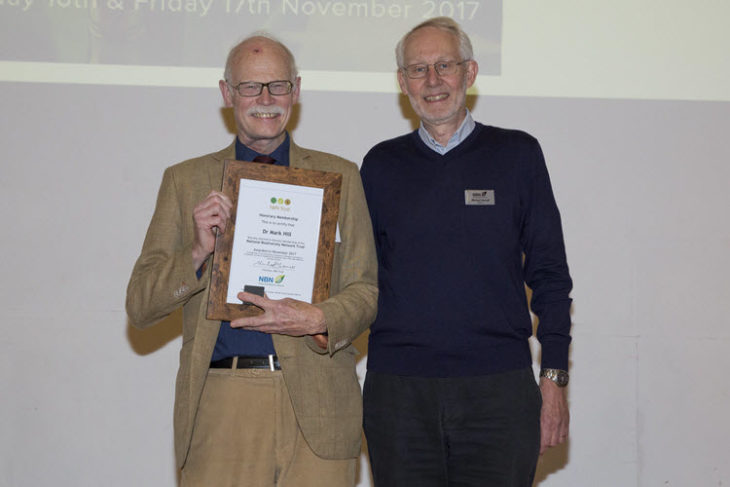 Mark Hill receiving Honorary Membership from Michael Hassell