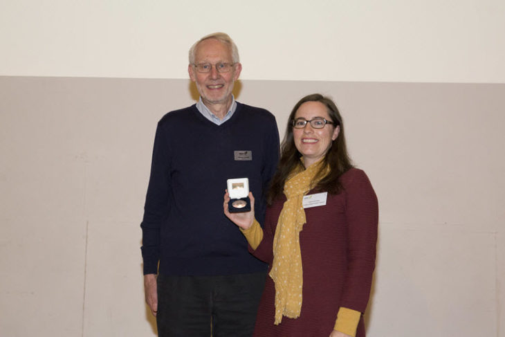 Yvonne Buckley receives the John Burnett memorial Medal from Michael Hassell