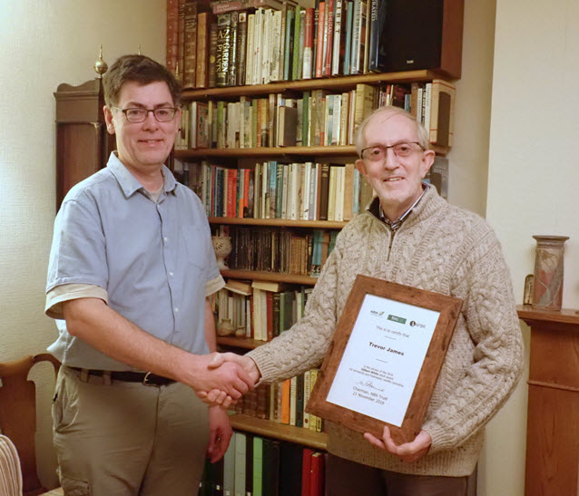 Trevor receiving certificate from Martin