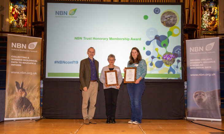 Neil Hodges presents the award to Sally Rankin (middle) and to Clare Blencowe on behalf of Mile Weideli