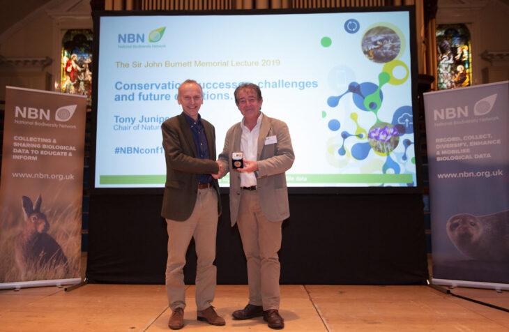 Neil Hodges presenting Tony Juniper with the Sir John Burnett Memorial Medal